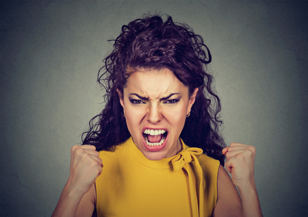 portrait of young angry woman screaming