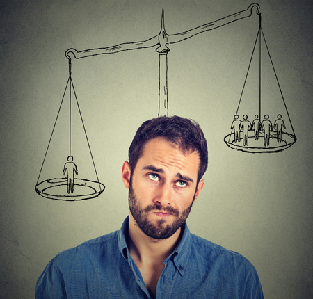 outweigh: Man making a decision with scale above head and people on a balance. Power, opinion, self importance concept. Human face expression, emotions