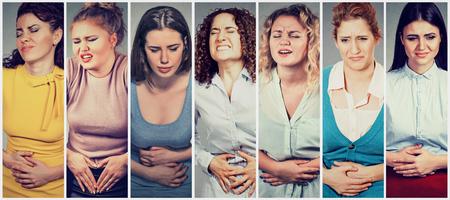 나쁜 통증 통증을 가진 뱃속에 손으로 젊은 여성 그룹
