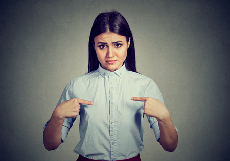 libel: Angry annoyed woman asking you talking to me? Isolated on gray background