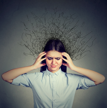 obsessive: closeup sad young woman with worried stressed face expression and brain melting into lines question marks. Obsessive compulsive, adhd, anxiety disorders Stock Photo
