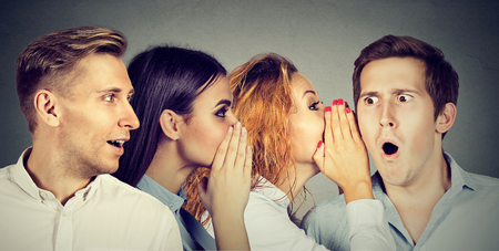 word of mouth: Group of young people men and women whispering each other in the ear. Word of mouth concept Stock Photo
