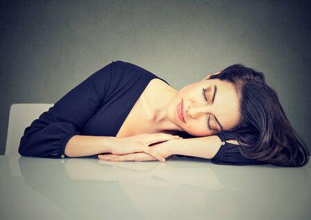 burdensome: Woman sleeping on a desk