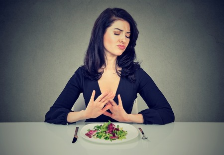 Young woman hates vegetarian diet Stock Photo
