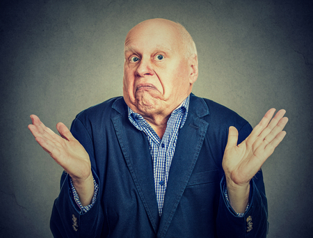 Senior confused man is shrugging his shoulders  Stock Photo