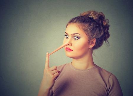 Woman liar with long nose  Foto de archivo