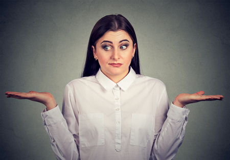 shrugs: young woman with arms out shrugs shoulders has no answer   Stock Photo
