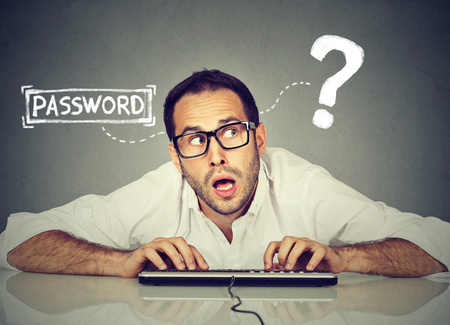 Man typing on the keyboard trying to log into his computer forgot password   Banco de Imagens