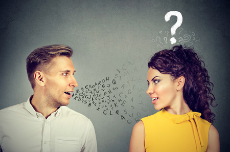 Man talking to an attractive woman with question mark