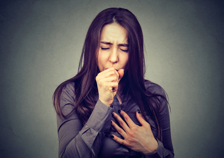 Woman coughing Stock Photo - 77590328