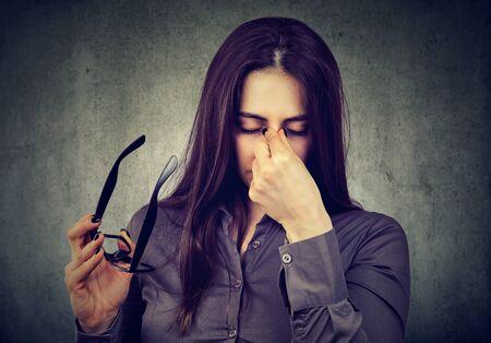 eyestrain: Woman with glasses suffering from eyestrain Stock Photo