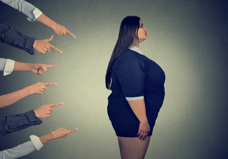 Many fingers pointing at fat woman