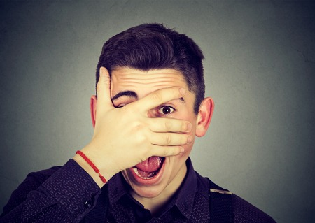man looking surprised in disbelief, with hand on face looking at camera Stock Photo - 78950403