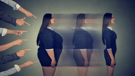 transforms: Intimidated obese woman transforms her body through strict new diet becomes a slim girl Stock Photo