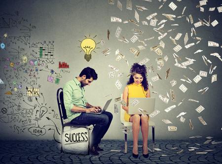 generates: Smart man working on computer generates ideas next to a woman using laptop under money rain