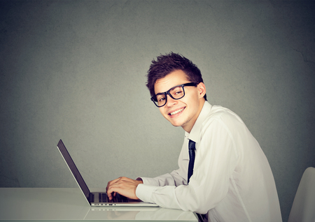 Technology geek man working on his laptop computer Stock Photo