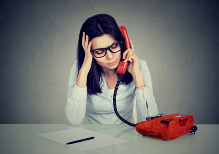 Serious stressed business woman on the phone Stock Photo