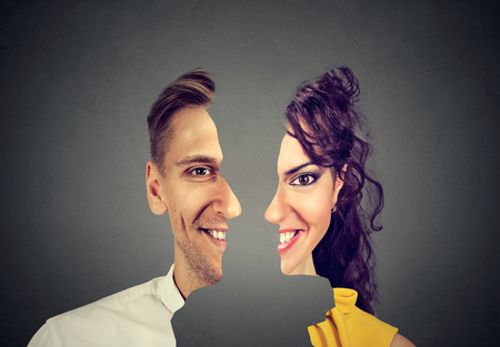 surrealistic portrait front with cut out profile of a happy young man and woman isolated on grey wall background
