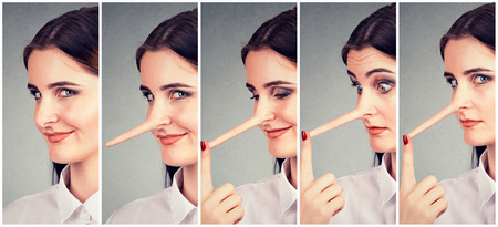 A liar transformation. Young woman with long nose
