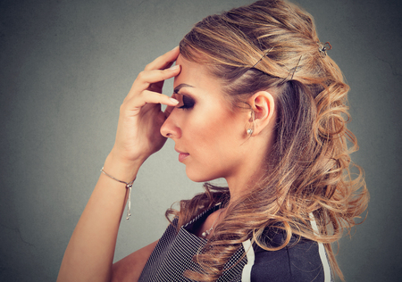 Serious woman thinking very hard Stock Photo