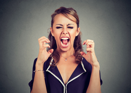 Angry frustrated young woman screaming
