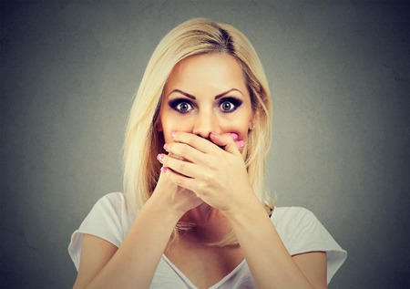 woman covering her mouth with hands scared to speak out about abuse and domestic violence