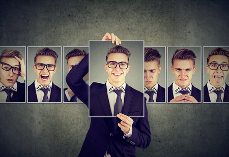 Positive masked man in glasses expressing different emotions  Stock fotó