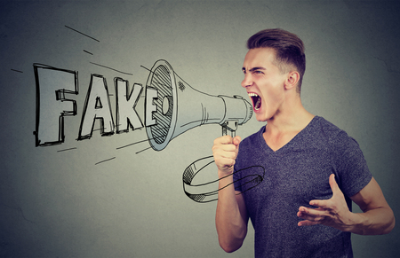 Angry enthusiastic man screaming in a megaphone spreading fake news