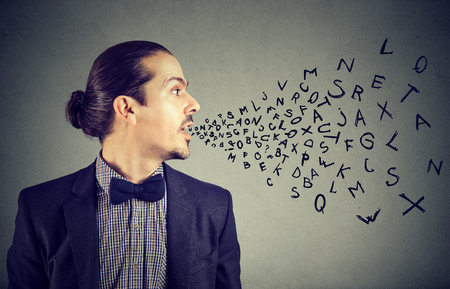 Man talking with alphabet letters coming out of his mouth. Communication, information, intelligence concept Stok Fotoğraf