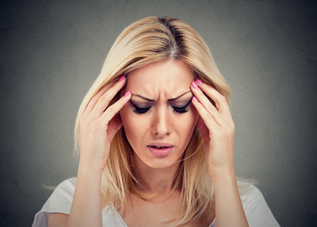 Closeup portrait sad woman with worried stressed face expression looking down Stock Photo