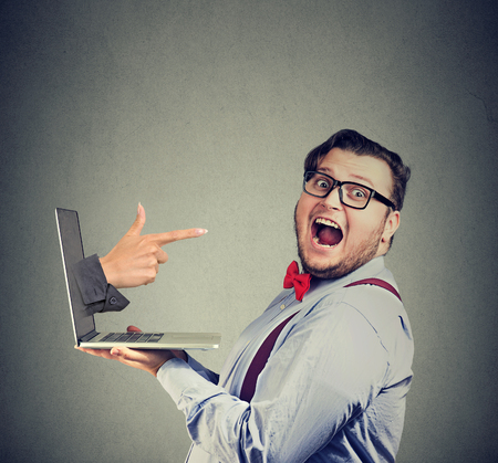 Young man holding laptop looking excited being picked won lottery in the Internet.
