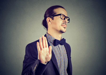 Young elegant man in eyeglasses stopping with hand while looking annoyed and insulted. Stok Fotoğraf - 95480895