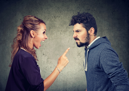 quarrel between young angry man and frustrated woman Stock Photo