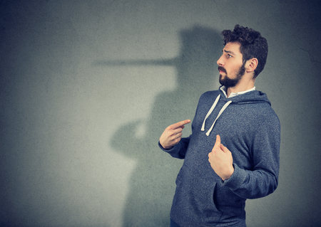 Side view of elegant man looking surprised when being caught on lie.  Standard-Bild