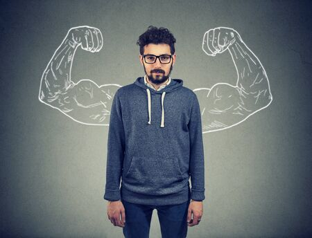 Strong confident young man hipster