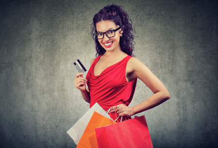 Beautiful young woman with shoppping bags and credit card Stock Photo