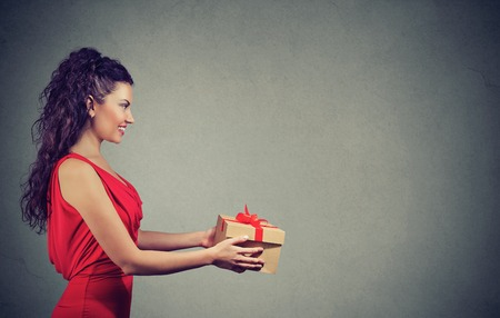 Beautiful woman giving a great present Stock Photo