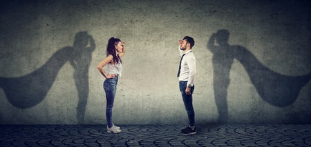Side view of a man and woman imagining to be a super hero looking aspired.  Stock Photo
