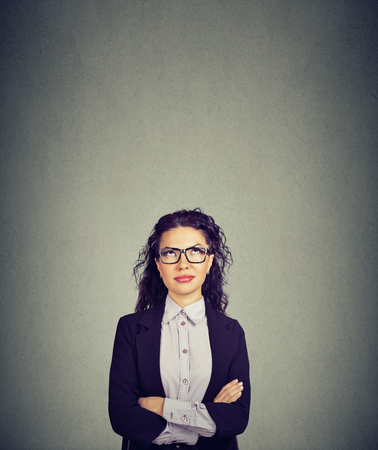 thoughtful business woman in glasses looking up Stock Photo