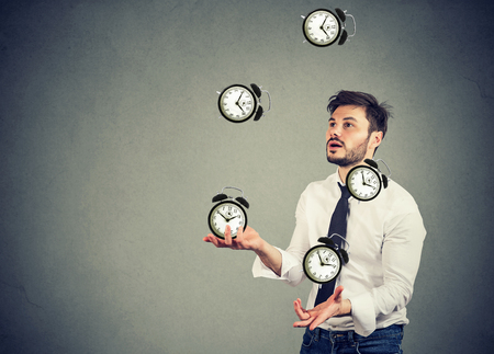 business man successfully juggling managing his time  Stock Photo