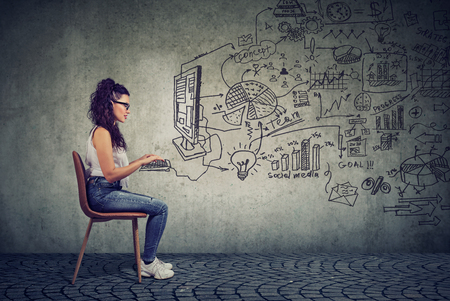 Hipster young business woman working in an office on computer brainstorming a start up plan  Stock Photo