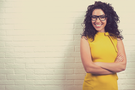 Portrait of a smiling young beautiful woman in glasses  스톡 콘텐츠