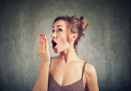 Woman doing a hand breath test. Stock Photo