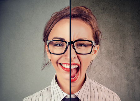 Bipolar disorder concept. Young woman with double face expression isolated on gray background