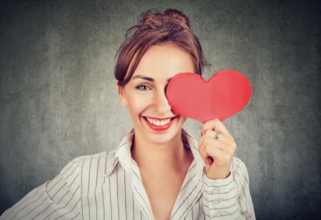 Beautiful charming woman holding red heart shape Banco de Imagens