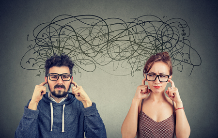 Angry displeased couple woman and man ignoring not listening each other exchanging with many negative thoughts Stok Fotoğraf