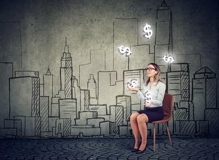 Businesswoman juggling with dollar symbols