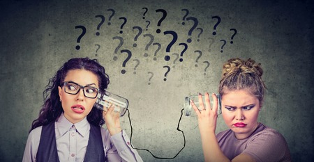 Two funny looking women having troubled communication Standard-Bild - 110068543