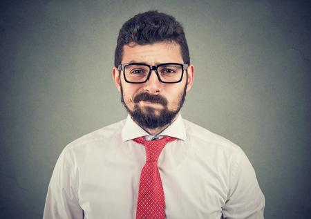 Skeptical doubtful businessman looking at camera Imagens