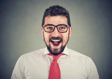 portrait of super excited surprised businessman Imagens